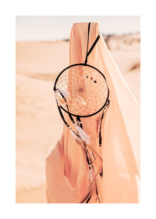 – Photograph of peach coloured fabric with a black dream catcher