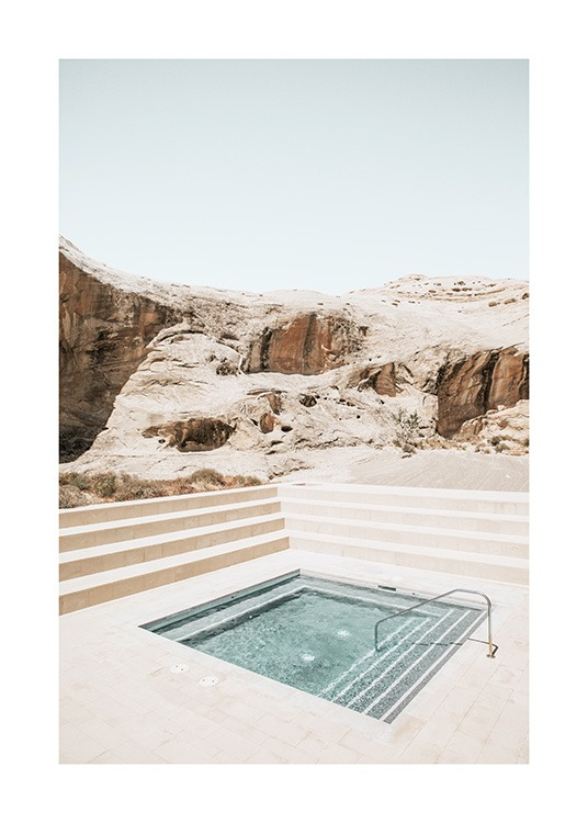 – Photograph of canyons behind a square pool surrounded by stairs