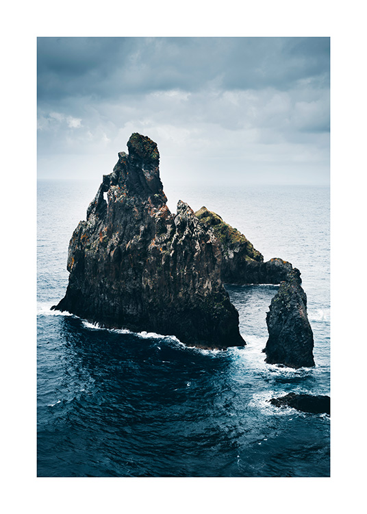 - Photograph of blue ocean with large rock formations in the middle