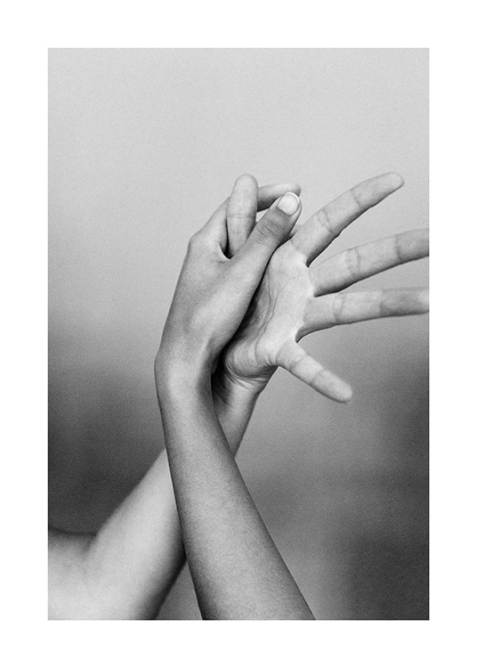 - Black and white photograph of two hands with entangled fingers