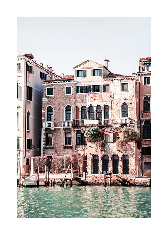 - Photograph of the canal in Venice with old houses and buildings next to the water