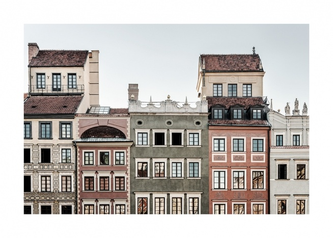 - Photograph of colourful facades of houses besides each other