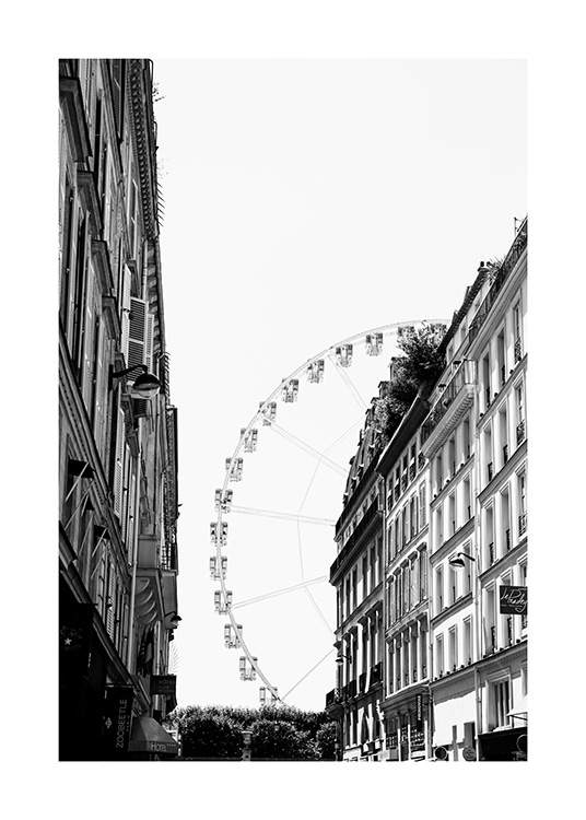 - Black and white photograph of a ferris wheel in Paris with house facades in front