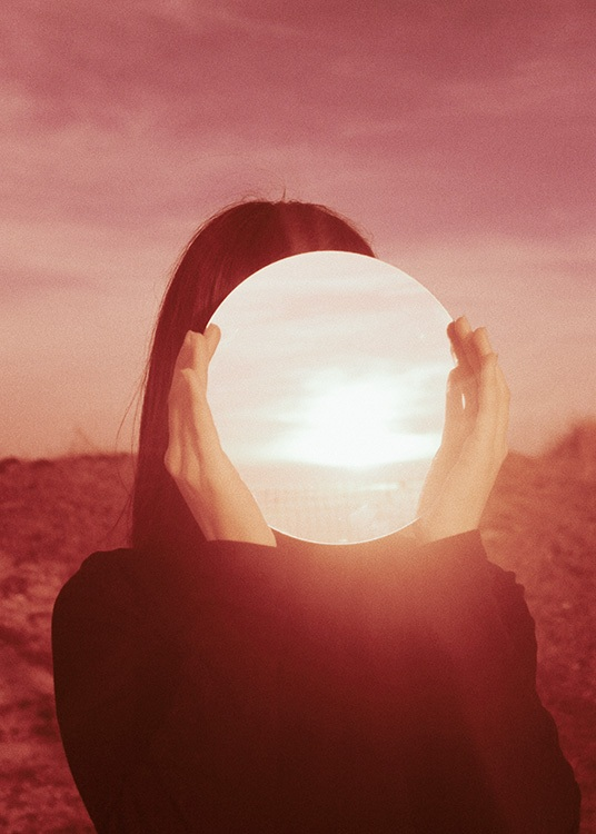 - Photo art with a girl holding a sunlight circle in front of her face