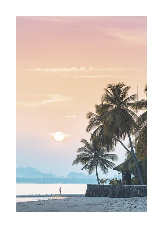 – Photograph of a pink and orange sky behind palm trees on a beach