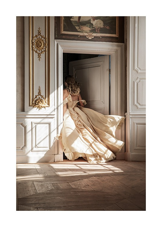 – Photograph of a woman in a beige dress walking through a door with baroque details