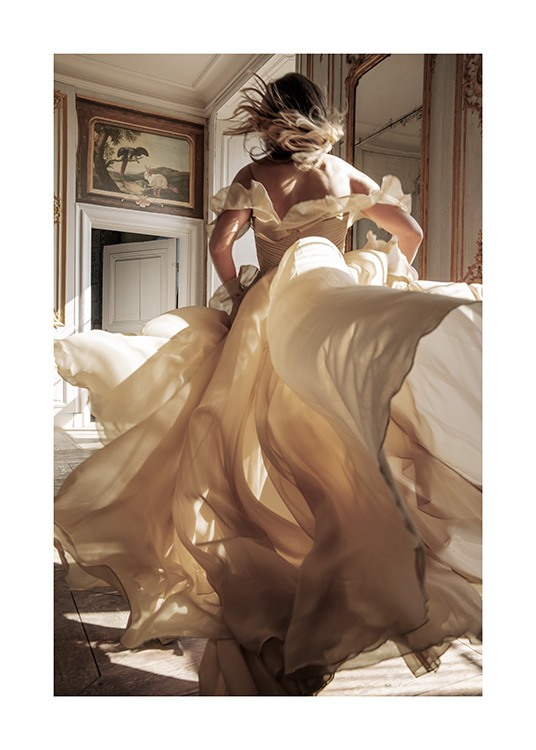 – Photograph of a woman running through a room in a beige dress, with a painting and mirrors in the background