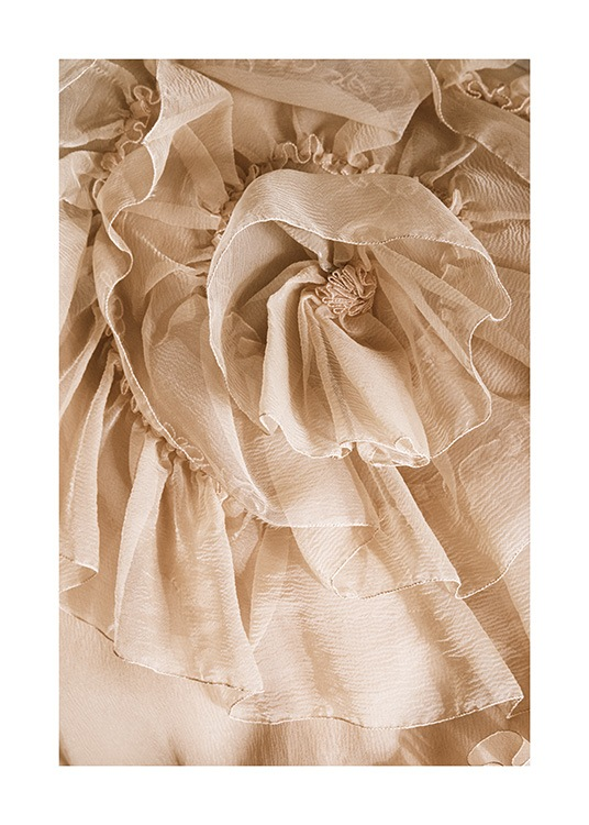– Photograph of ruffled tulle fabric in beige, resembling a flower