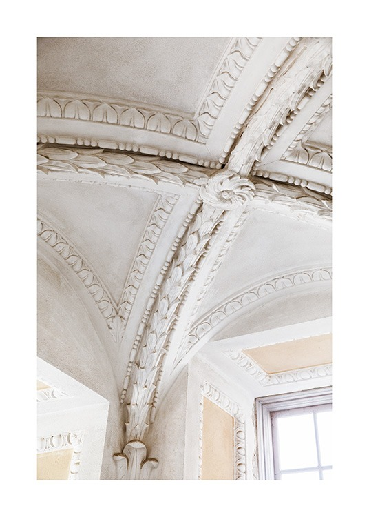 – Photograph of carved out details of a beige, baqorue ceiling