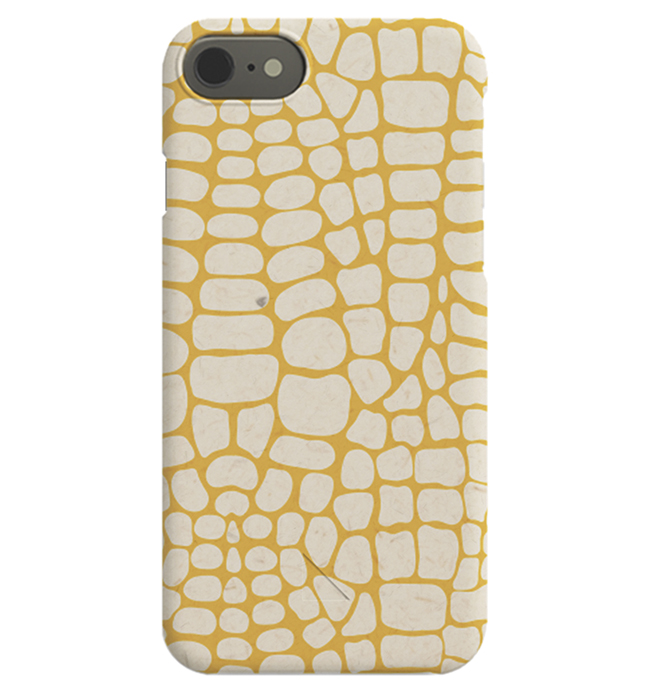 – Beige and orange iPhone case with small, beige shapes on an orange background