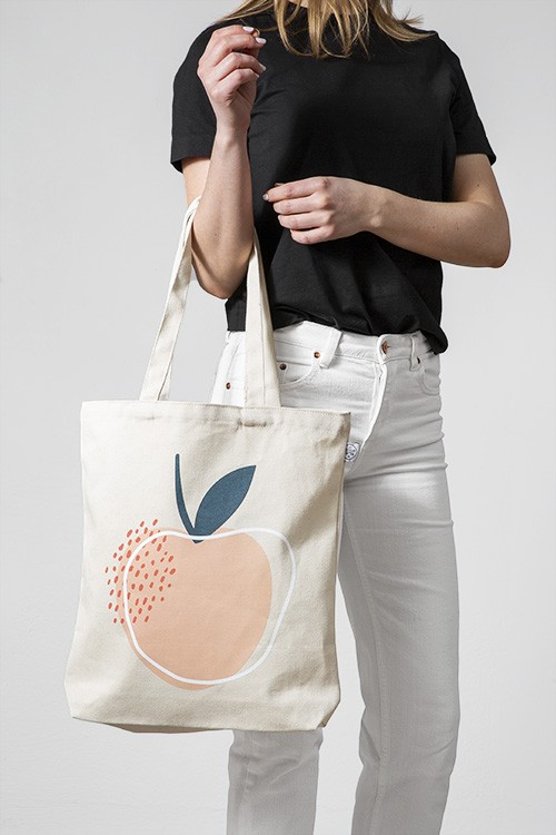– Beige tote bag with an illustration of a peach, pink dots and a white circle printed on the front