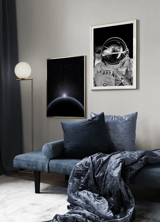Modern dark blue décor with astronaut poster